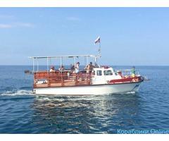 Морские прогулки и рыбалка на катере в Адлере